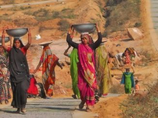 Women carrying dirt for trailside