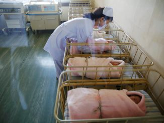A nurse takes care of a newborn baby at the neonatal ward of the Pyongyang Maternity Hospital during a visit by foreign reporters on a government organised tour in Pyongyang